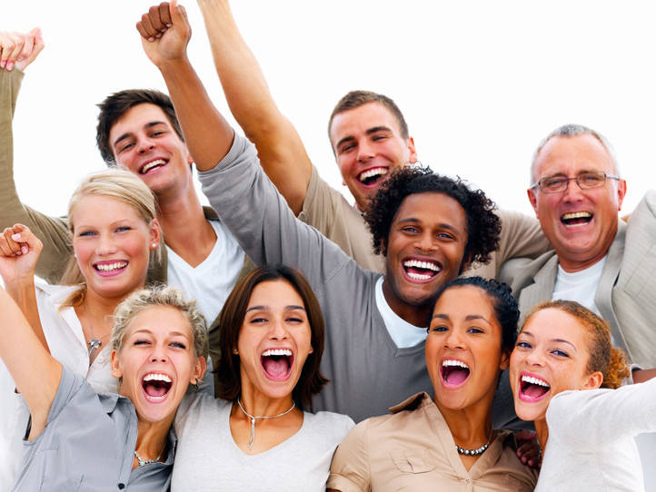 Portrait of a group of business people laughing against white background